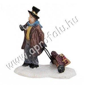 Hölgy gurulós bőrönddel