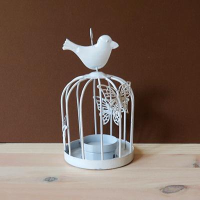 Fehér fém mécsestartó kalitka,madárral, pillangóval, felakasztható.