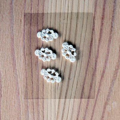Ornamentika,szilikon,  4 darab. Mérete: 15x9 mm