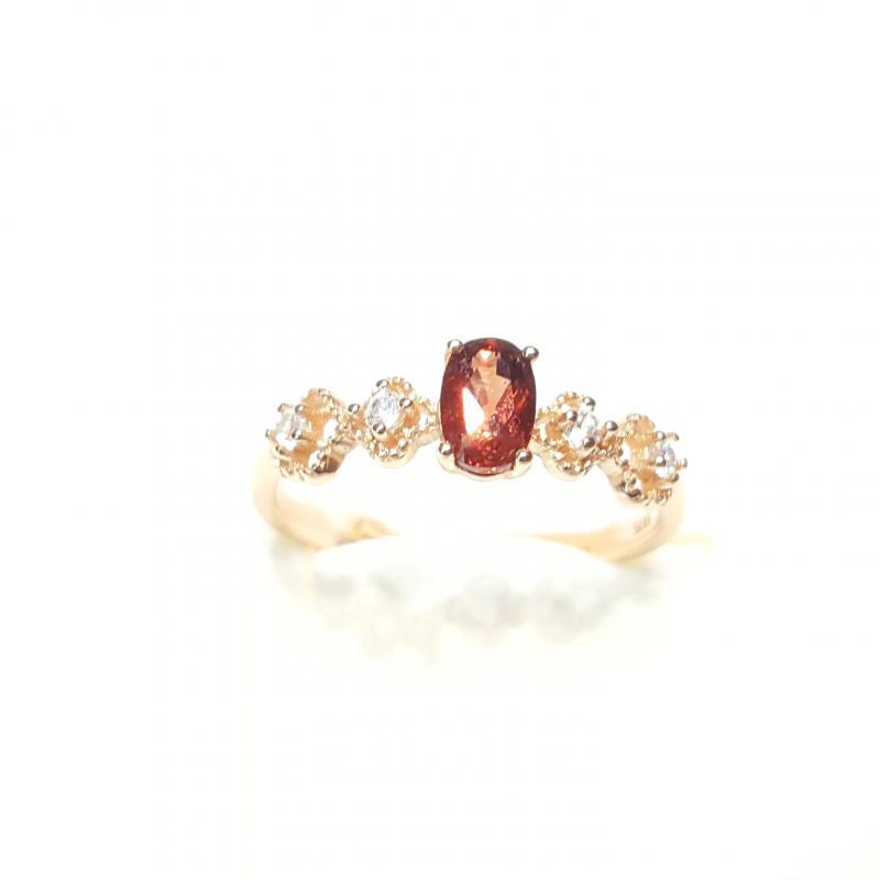 Aranyozott ezüst gyűrű gránát kővel 229