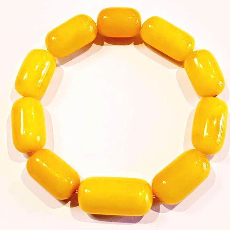 Borostyán karkötő sárga opak hengeres forma 906