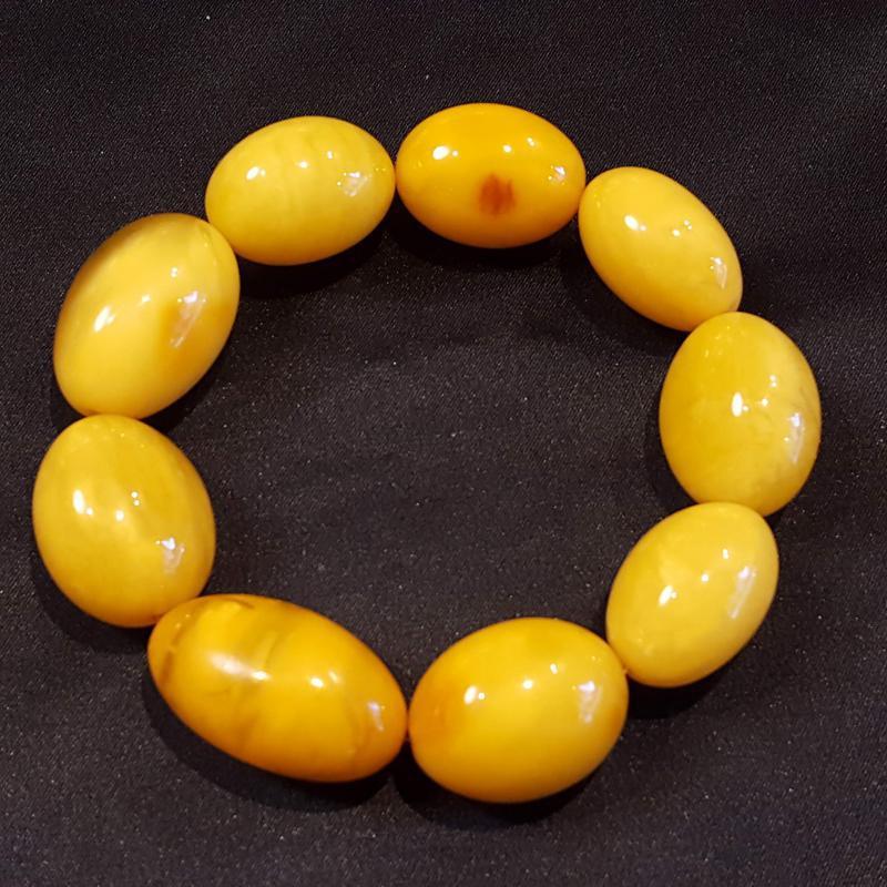 Borostyán karkötő sárga opak nagyméretű bogyók gumis 901