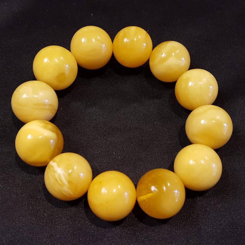 Borostyán karkötő sárga opak nagyméretű gömbök 904