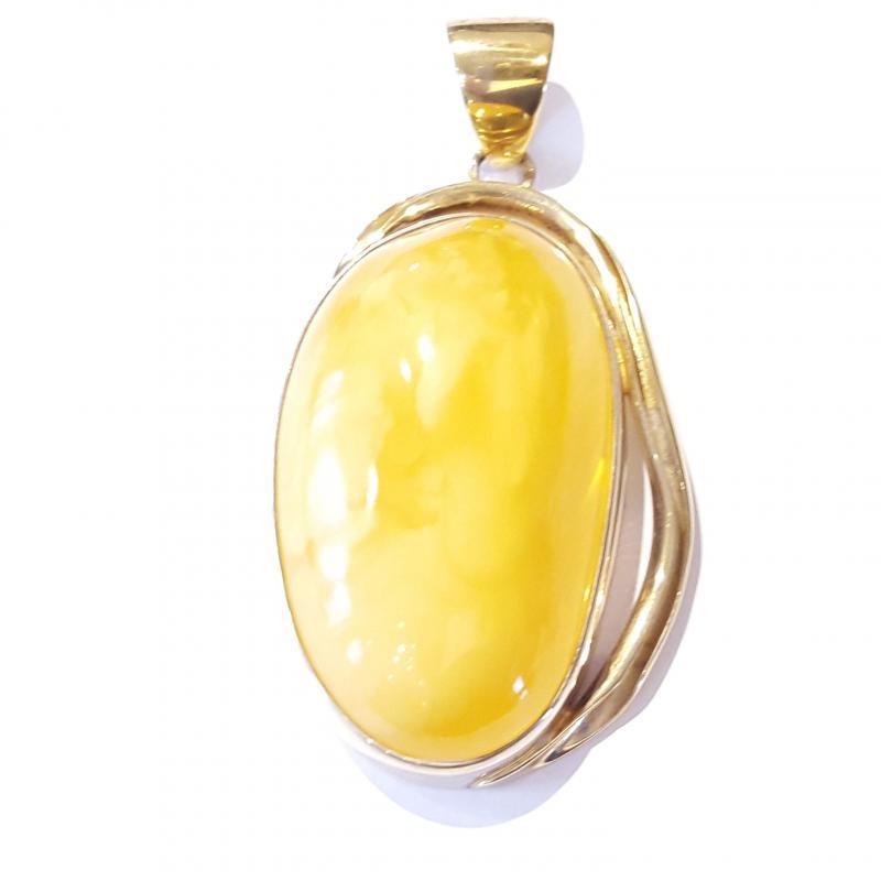 Borostyán medál sárga opak aranyozott ezüst foglalatban 429