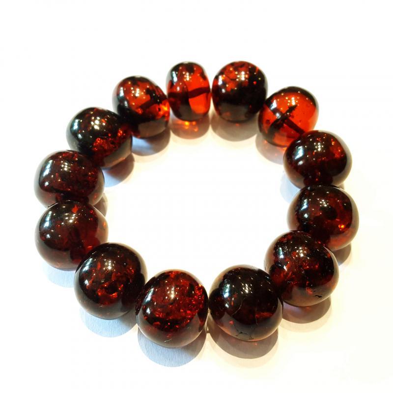 Borostyánkő karkötő barokk gyöngyökből sötét gumis 586