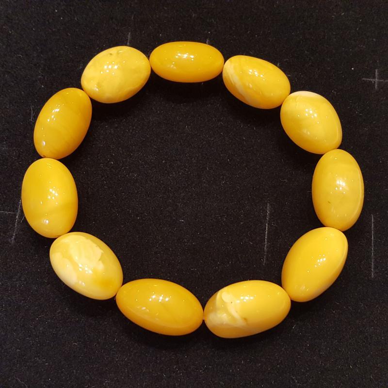 Borostyánkő karkötő ovális gyöngyök opak gumis 591