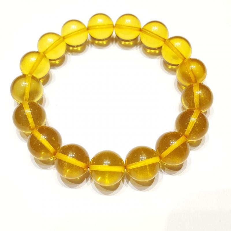 Borostyánkő karkötő szabályos  gyöngyökből világos gumis 571
